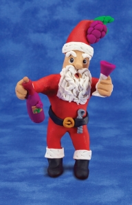 clay sculpture of Santa with wine glass